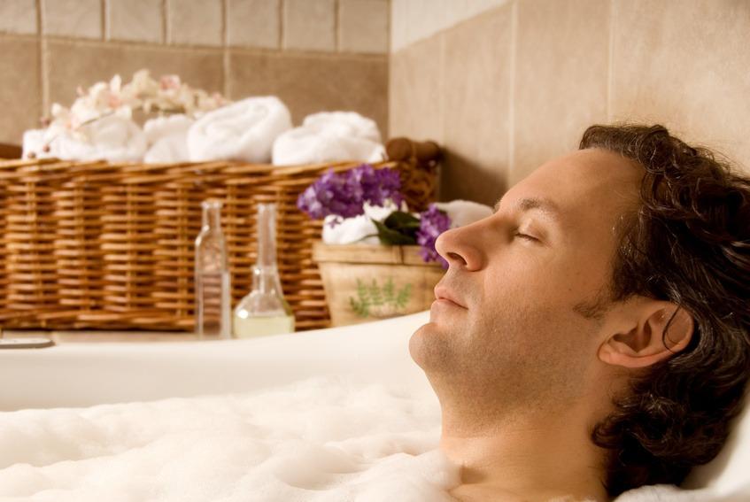 man client in a spa taking an aroma bath